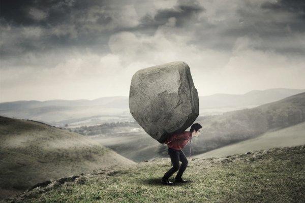 depositphotos_128641282-stock-photo-businessman-carrying-rock-at-hill